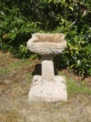 Birdbaths: A carved Cotswold stone Arts and Crafts style birdbath, early 20th century, 54cm