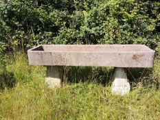 Troughs/Planters: A carved sandstone rectangular trough raised on two staddlestone bases, 88cm