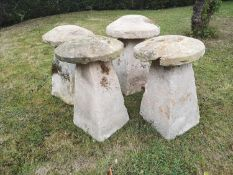 Staddlestones: A harlequin set of four Cotswold stone staddlestones, average height 74cmThe Cotswold