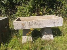 Troughs/Planters: A rectangular carved stone trough on two staddlestone supports, 83cm high by 128cm