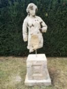 Architectural stone: An early fragmentary carved stone torso of a woman, on Cotswold stone pedestal,