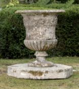 Garden pots/planters: A substantial carved Cotswold stone urn, 18th century, on associated octagonal