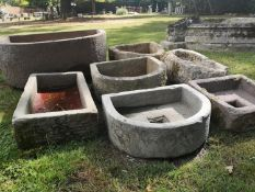 Troughs/Planters: A collection of six troughs, some with drainage holes, the largest 75cm longThe