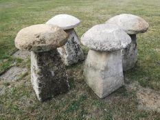 Staddlestones: A harlequin set of four carved Cotswold stone staddlestones, average height 76cmThe