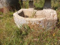 Troughs/Planters: A carved D-shaped Cotswold stone trough, 28cm high by 90cm long by 54cm deepThe