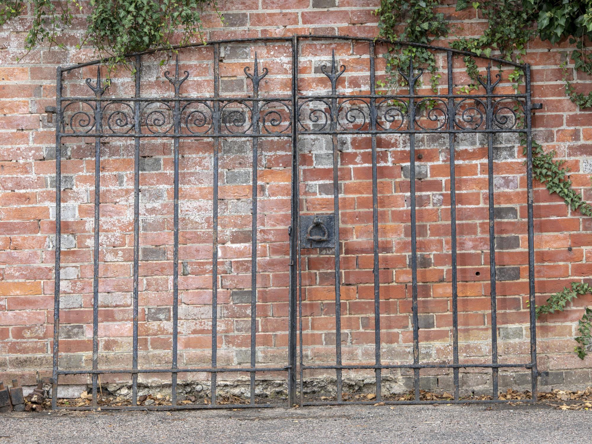 Lot 200 - Gates: A pair of wrought iron gates, late 19th century, 180cm high by 224cm wide