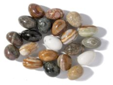 Minerals/Interior Design: A collection of 22 marble and onyx eggs in fossil marble bowlthe bowl