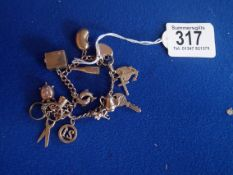 9ct gold charm bracelet with marked charms 28g