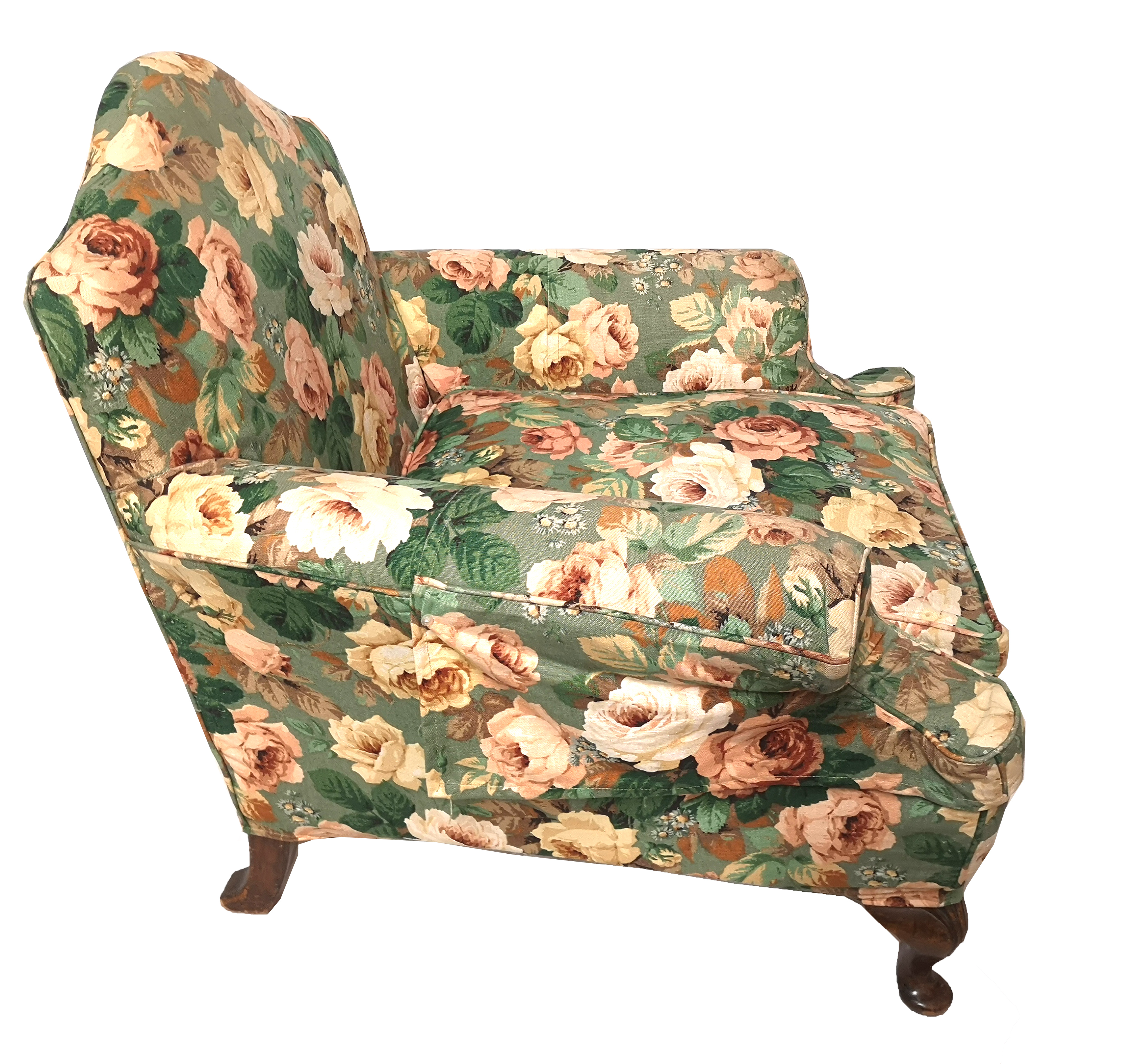 Lot 720 - AN EARLY 20TH CENTURY CLUB ARMCHAIR In a floral upholstery on a green ground, on squat mahogany