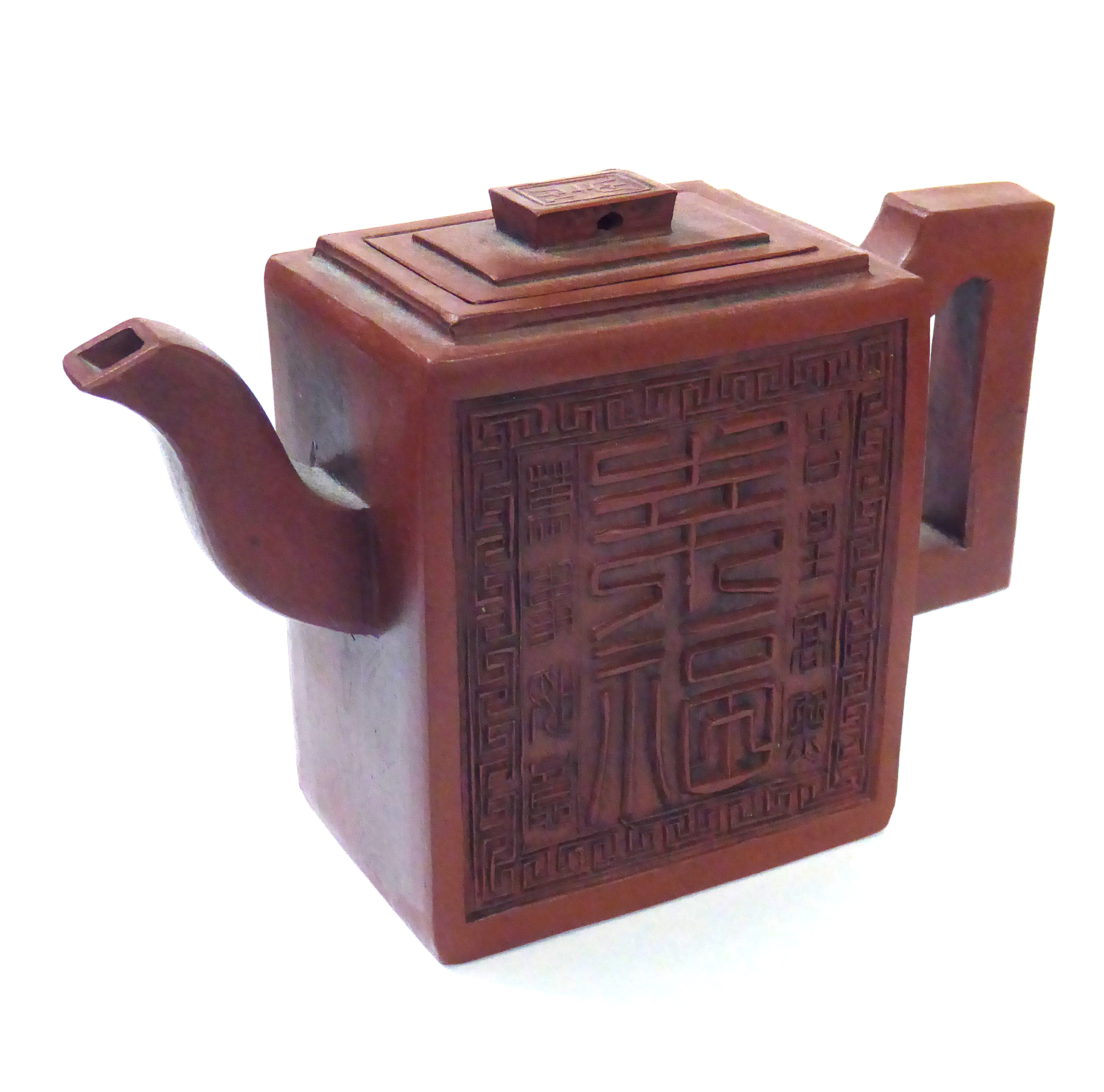 Lot 168 - A CHINESE YIXING TERRACOTTA TEAPOT Square form with raised Chinese characters and a four-character