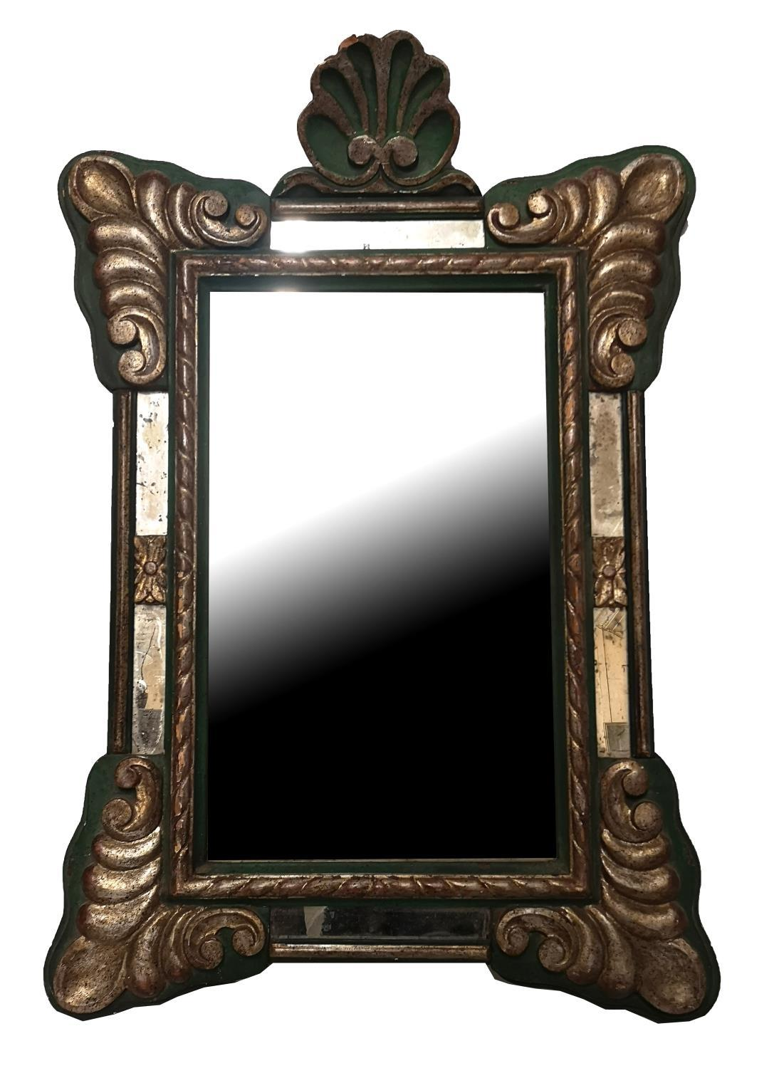 Lot 768 - A 19TH CENTURY CARTOUCHE FRAMED MIRROR With shell pediment and raised decoration, detailed on a