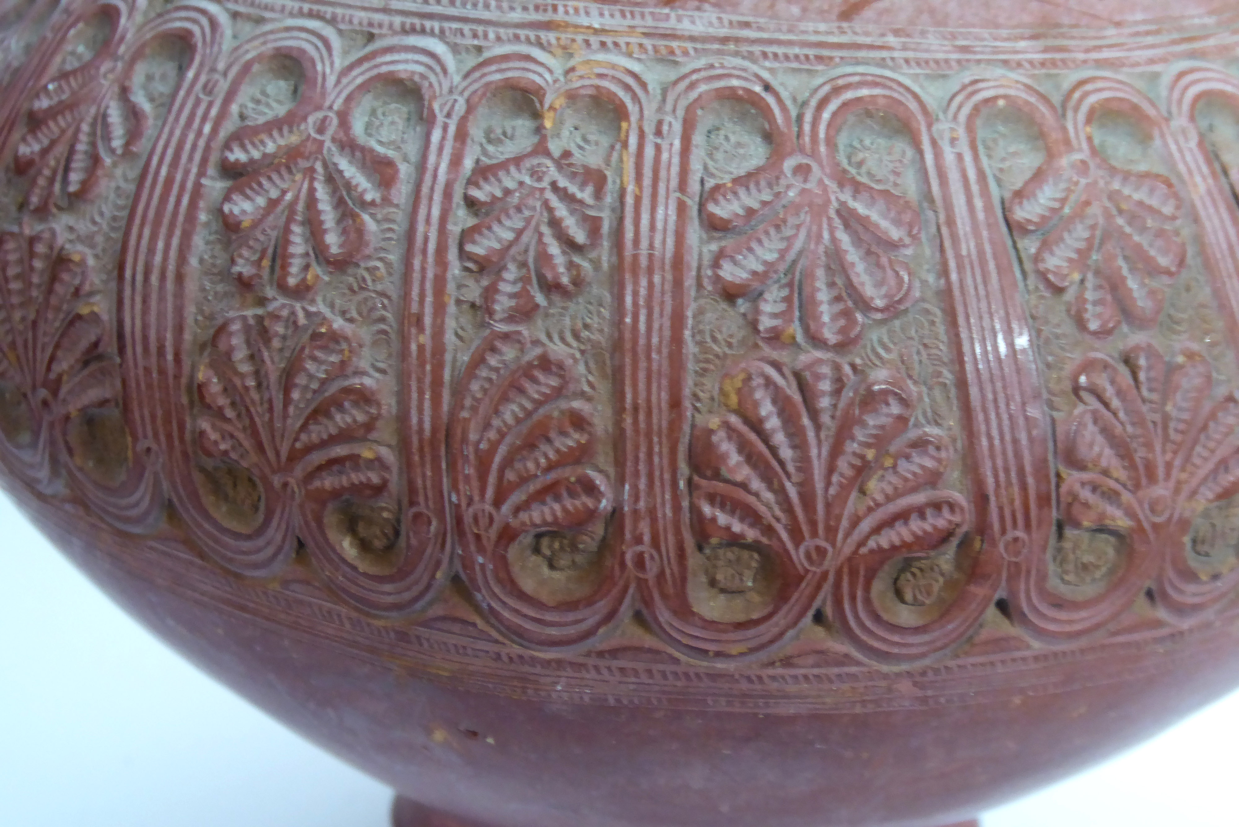 Lot 165 - A ROMAN SAMIAN WARE TERRACOTTA TWIN HANDLED VASE Finely carved with a band of anthemons and