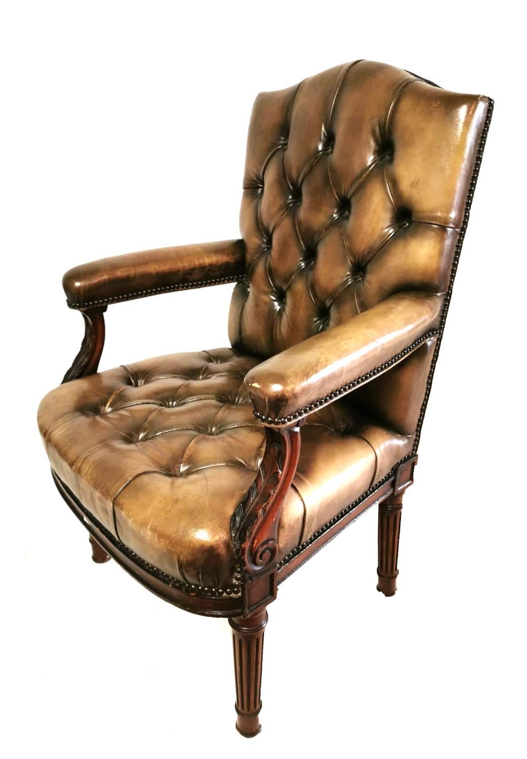 Lot 713 - A 19TH CENTURY MAHOGANY OPEN ARMCHAIR Upholstered in a green button back leather, with acanthus