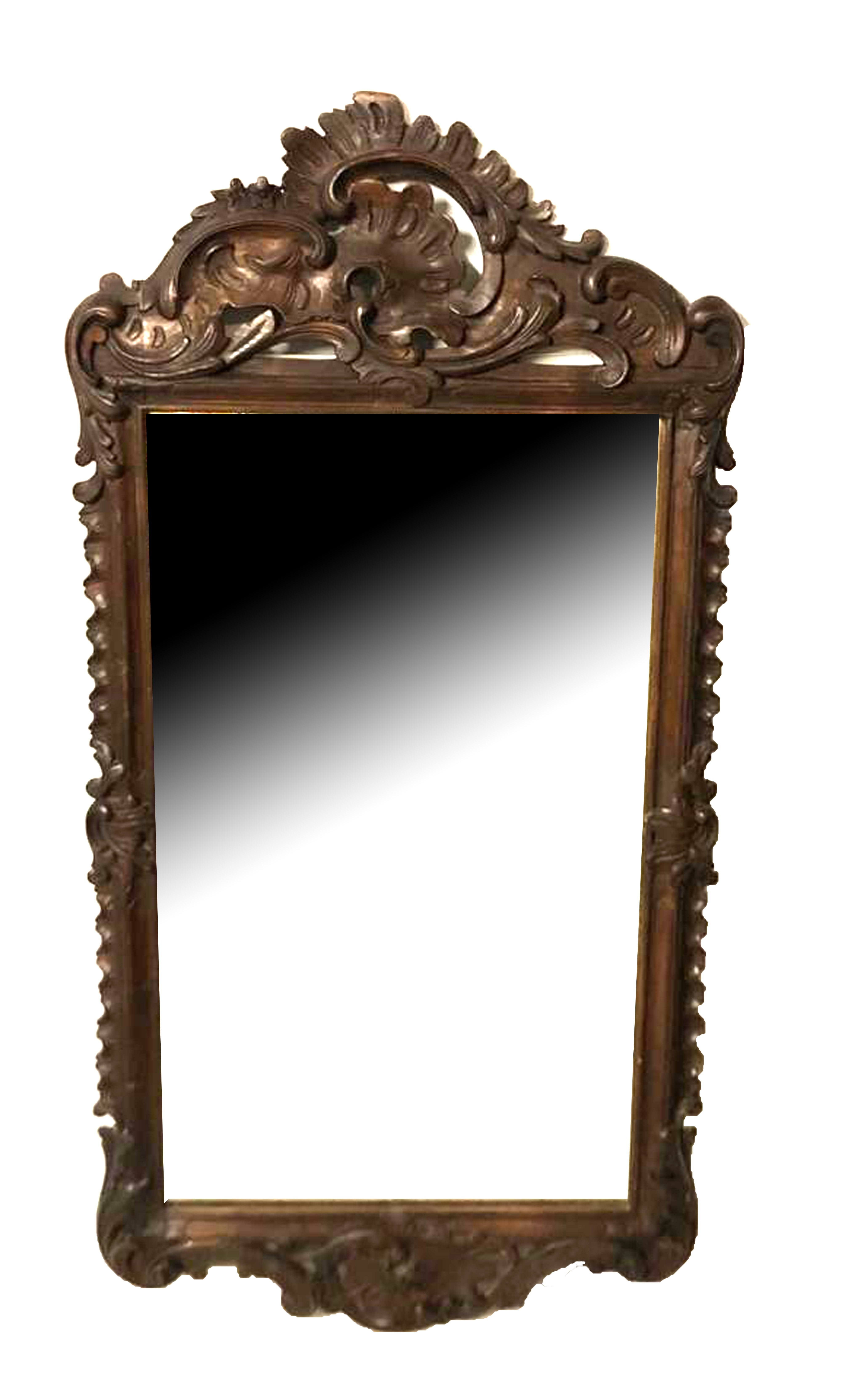 Lot 673 - A 19TH CENTURY ITALIAN CARVED PINE FRAMED MIRROR With pierced cartouche above a silvered plate. (