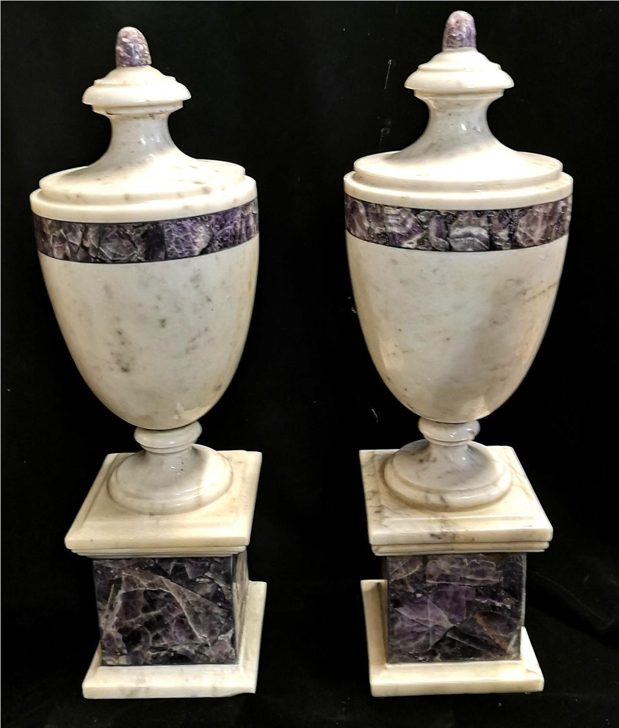 Lot 214 - A PAIR OF ITALIAN MARBLE URNS Classical form with amethyst marble banding.