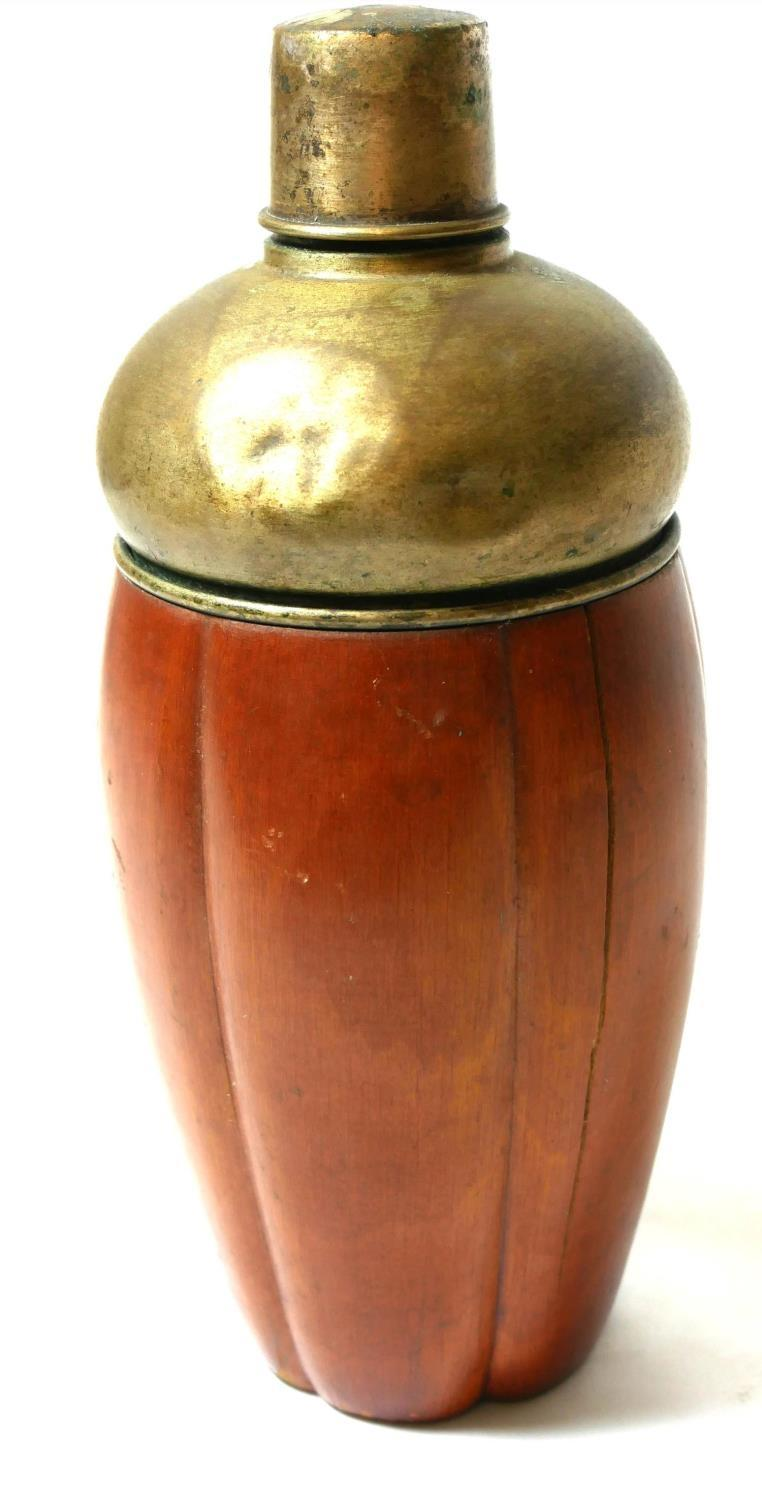 Lot 252 - A VINTAGE WHITE METAL AND FRUITWOOD CLAD COCKTAIL SHAKER. (24cm)