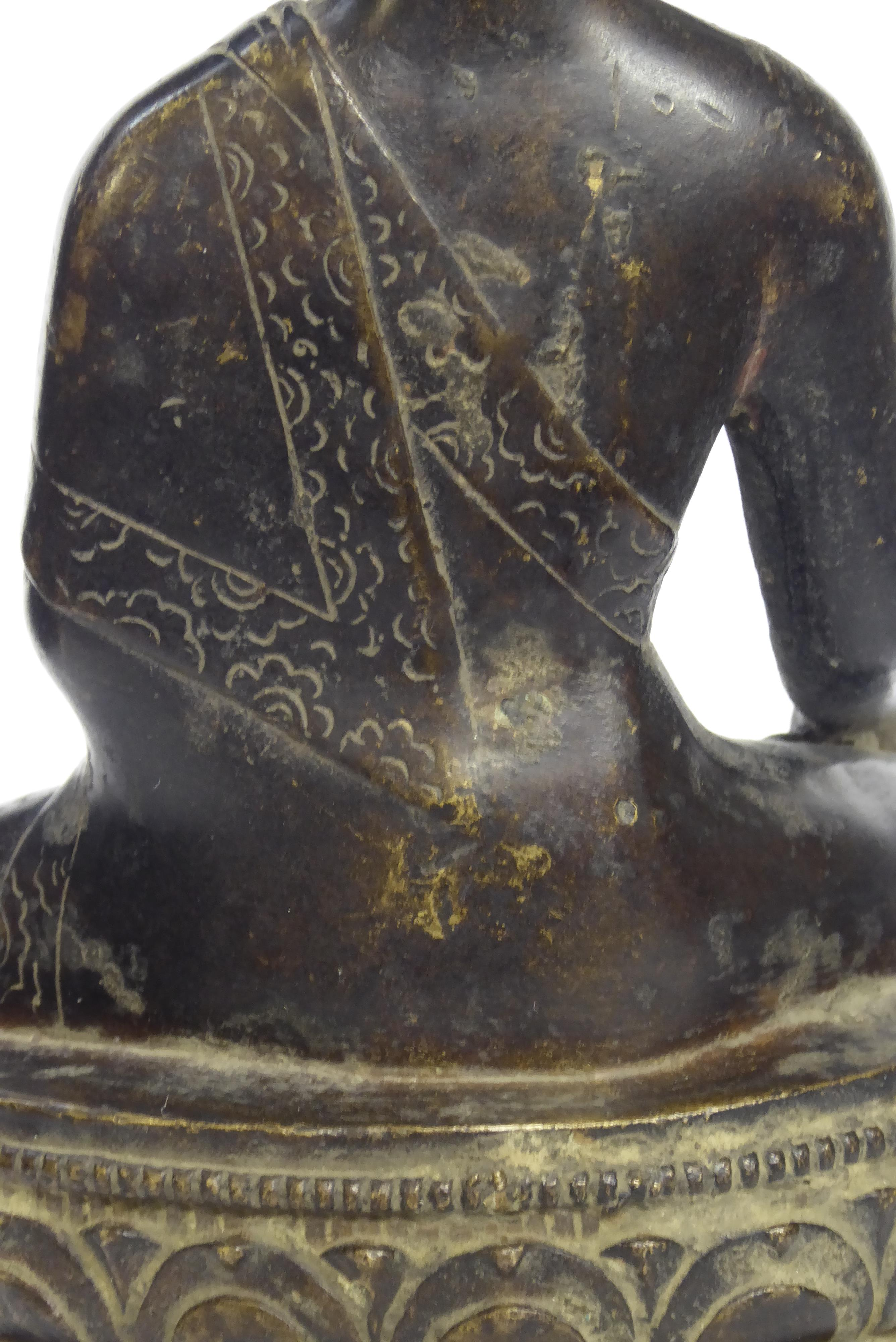 Lot 170 - A CHINESE BRONZE BUDDHA Seated pose with ceremonial vessel and double lotus base Bearing a label