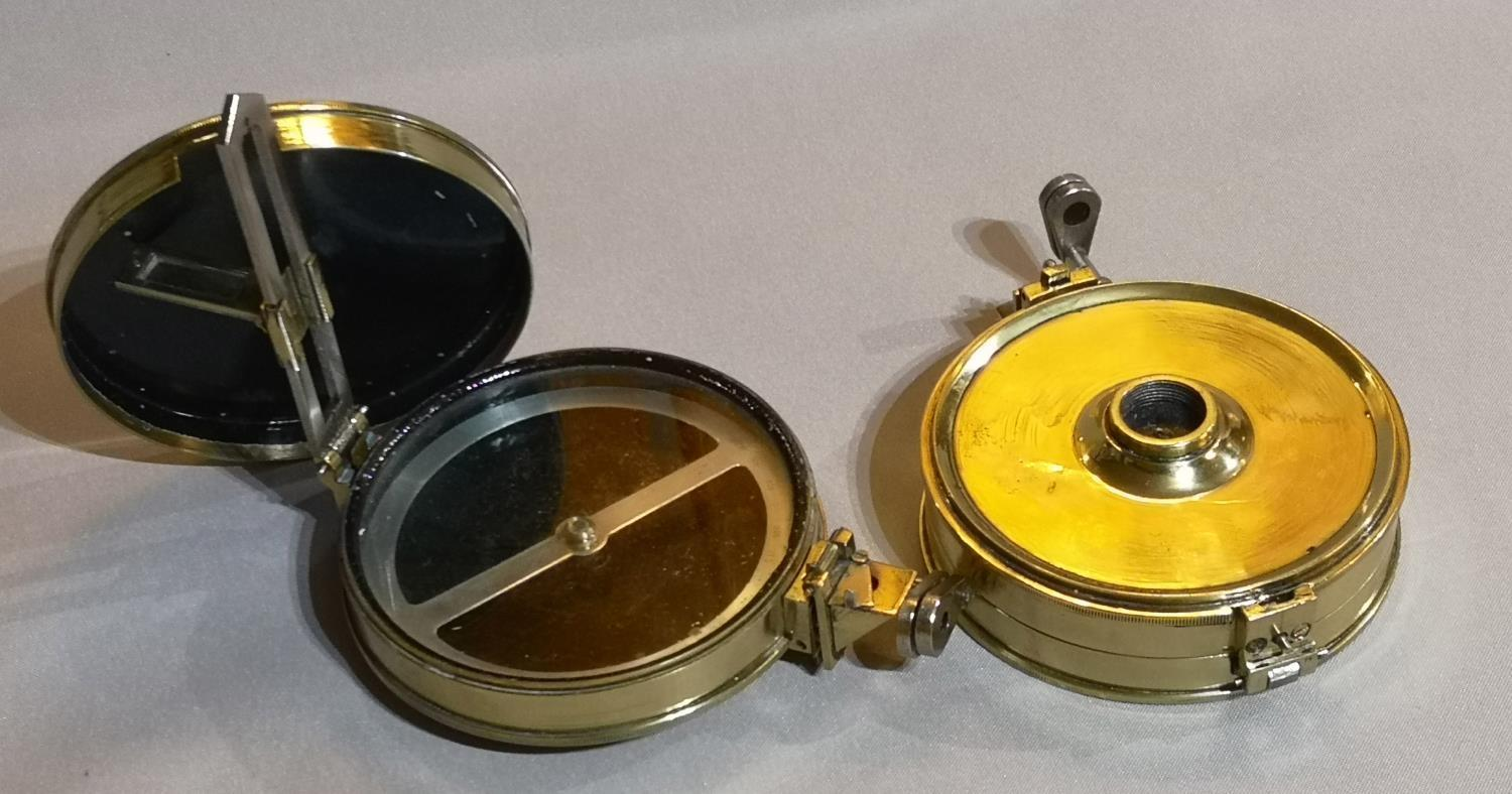 Lot 247 - A PAIR OF VICTORIAN BRASS DESK COMPASSES Circular form with steel dial and hinged sight. (approx