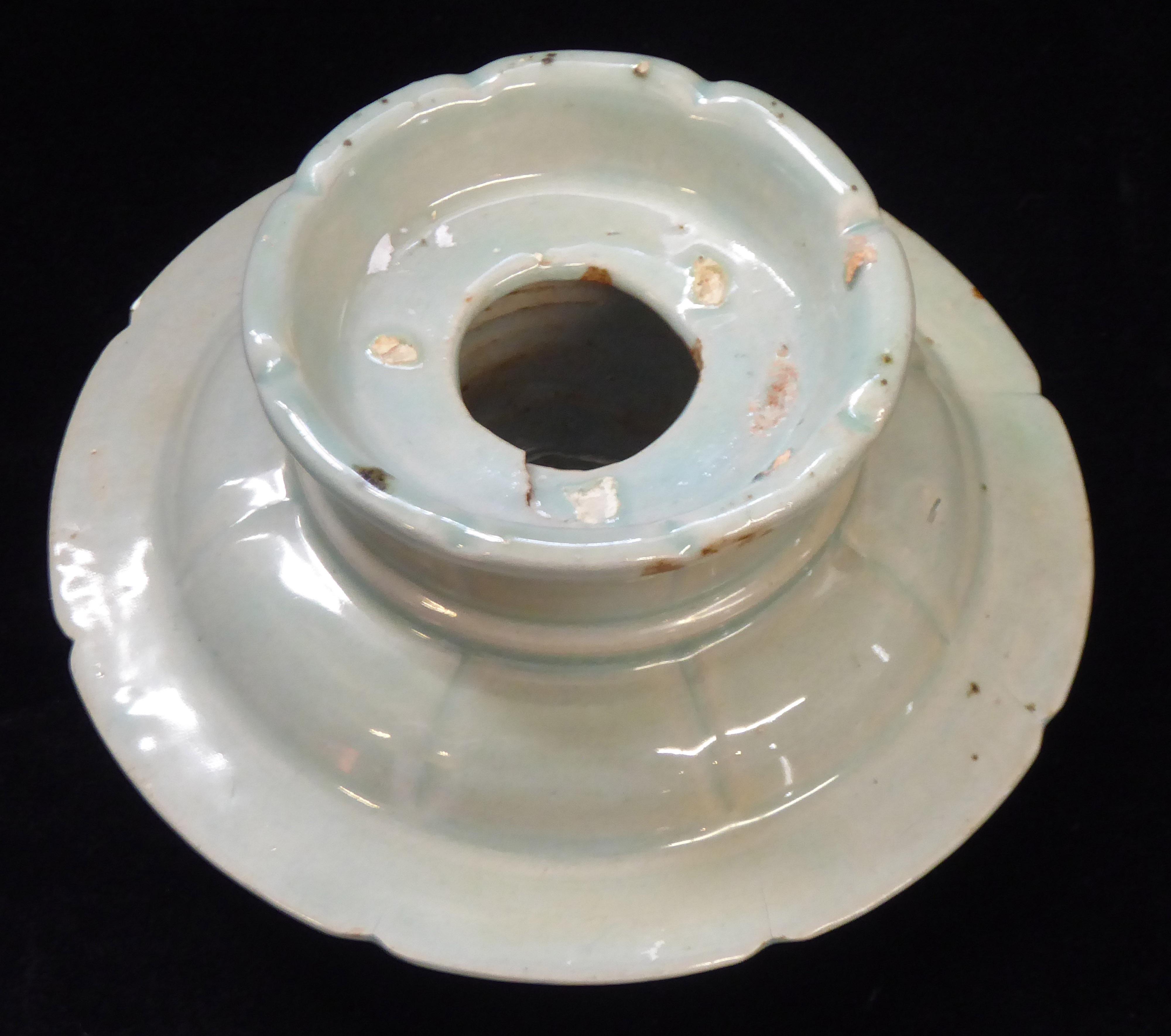 Lot 157 - A KOREAN GORYEO DYNASTY CELADON GLAZED POTTERY LOTUS DISH Spherical form having a raised platform