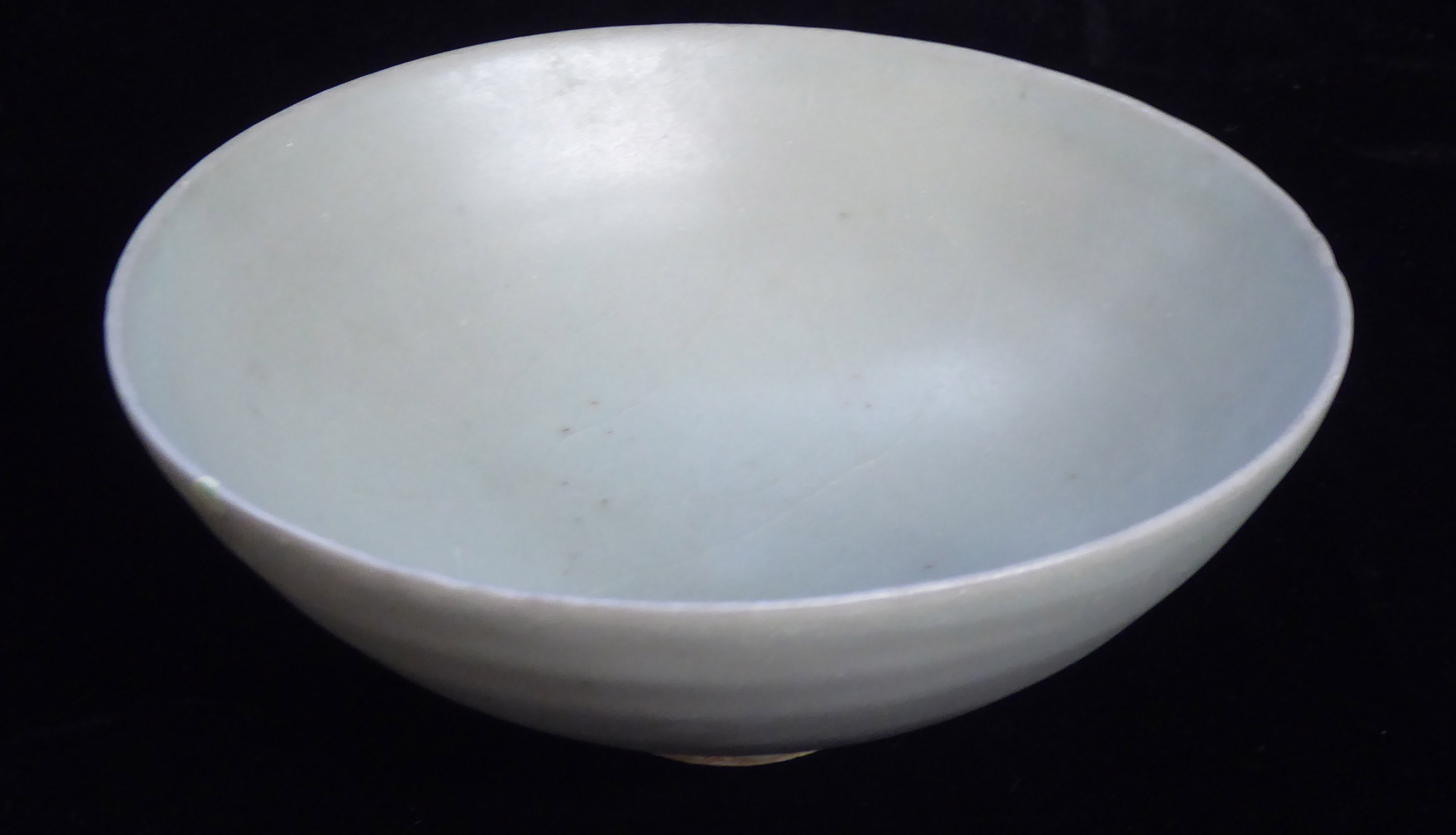 Lot 156 - A CHINESE YUAN DYNASTY LONGQUAN CELADON GLAZED POTTERY BOWL Of conical form of plain design. Bearing
