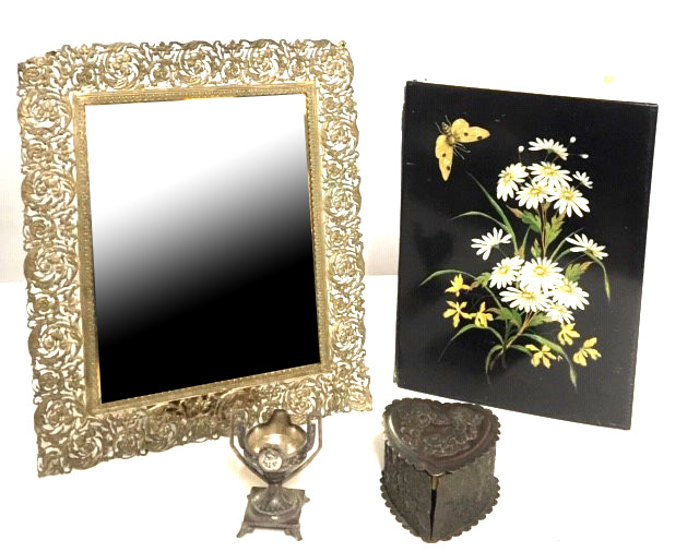 Lot 186 - AN EARLY 20TH CENTURY WHITE METAL EASEL MIRROR Having a scrolled pierced border with bevelled