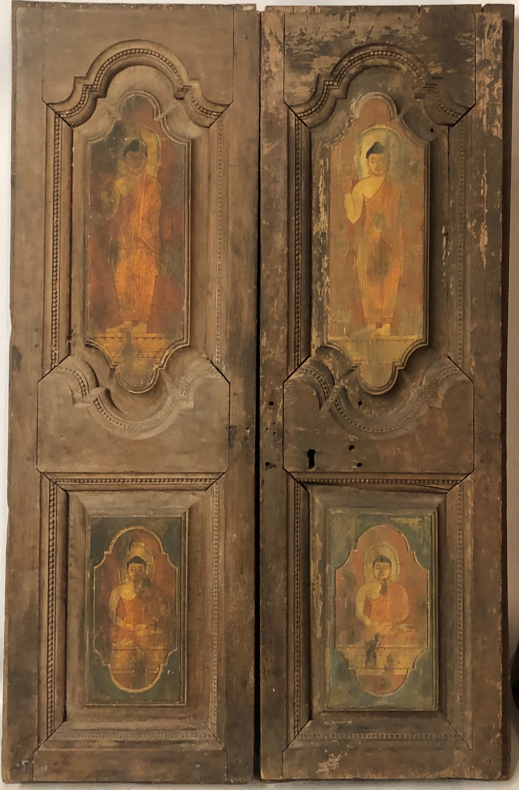 Lot 719 - A PAIR OF ANTIQUE INDIAN DOORS The ogee panels painted with Hindu gods. 100 x 155 cm