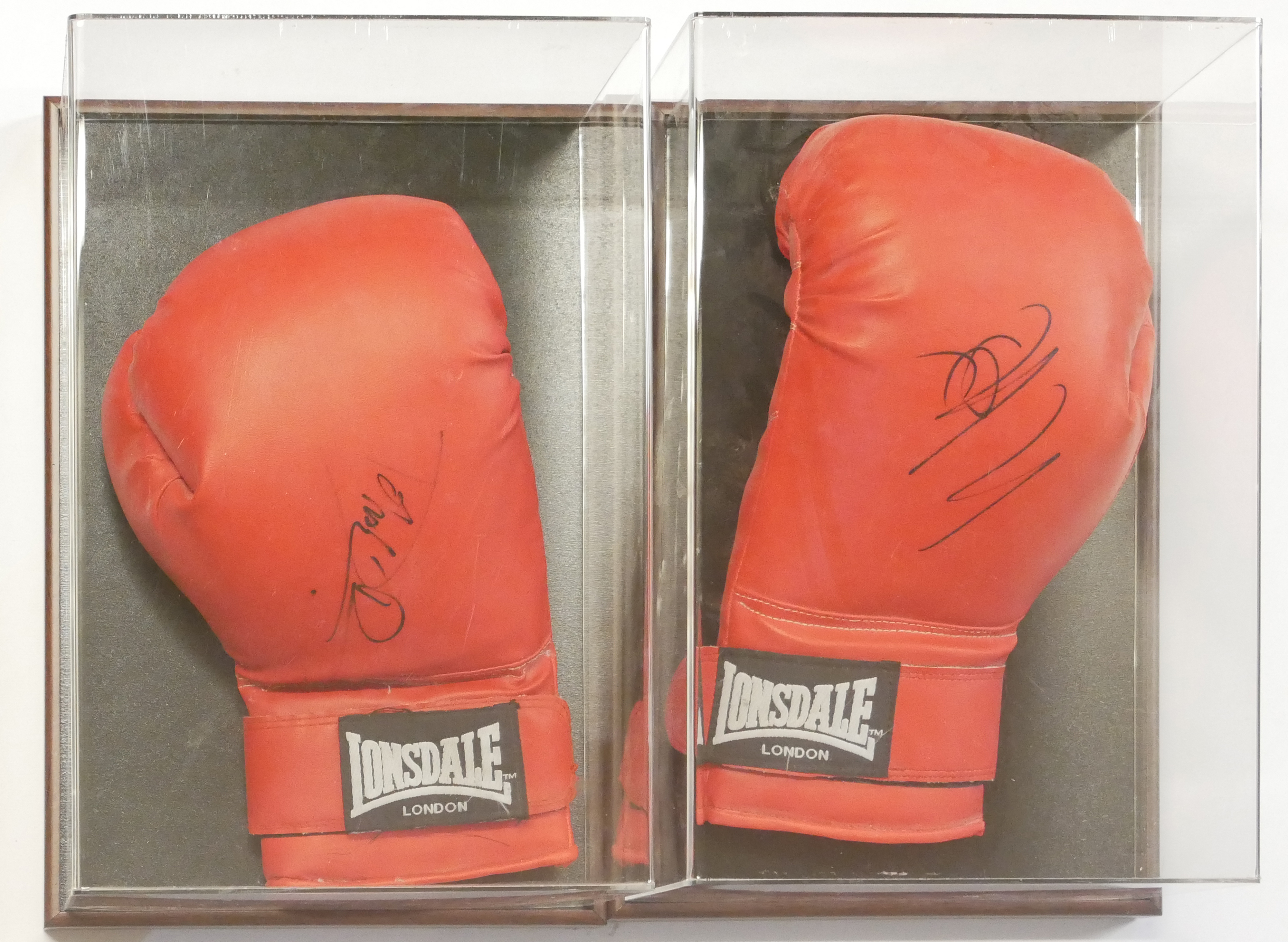 Lot 217 - A PAIR OF CASED AUTOGRAPHED LONSDALE BOXING GLOVES Hand signed by Sylvester Stallone and Dolph
