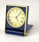 JAEGER LECOULTRE, A GUBELIN TRAVEL ALARM TIMEPIECE With date window, in simulated lapis lazuli case.
