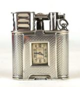 DUNHILL, AN ART DECO SILVER 'UNIQUE' WATCH LIGHTER Having engine turned decoration and hinged