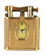 DUNHILL, AN ART DECO 9CT GOLD WATCH LIGHTER Square form with engine turned decoration and hinged