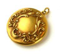 A 14CT GOLD CIRCULAR VICTORIAN DESIGN LOCKET With relief floral cartouche. (3cm) Condition: good