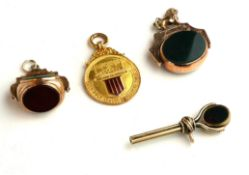TWO EARLY 20TH CENTURY 9CT GOLD AND HARDSTONE SWIVEL WATCH FOBS Comprising a double side fob with