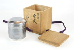A CHINESE SILVER SPHERICAL CUP AND COVER With concentric rings and signature mark to base, in bamboo