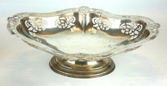 A VINTAGE SILVER OVAL CAKE BASKET Pierced decoration, on a pedestal base, hallmarked Sheffield,