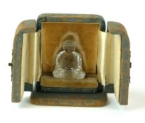 A 19TH CENTURY ROCK CRYSTAL MINIATURE STATUE OF A SEATED BUDDHA In velvet lined fitted leather case.