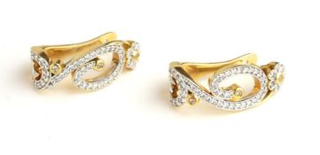 A PAIR OF 18CT GOLD AND DIAMOND EARRINGS Having a pavé set diamond scrolled design within a round