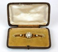 A LATE 19TH CENTURY NATURAL PEARL BROOCH Floral form, in yellow metal setting, contained in original