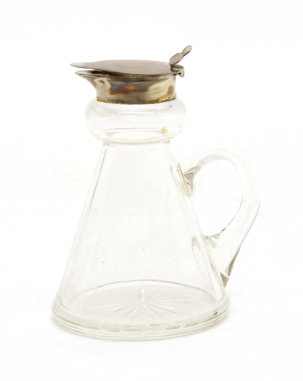 A silver mounted whisky noggin,