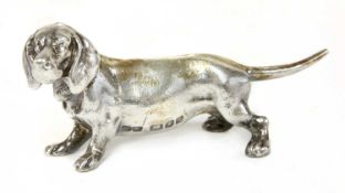 A cast silver figure of a dachshund,