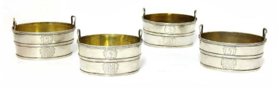 A set of four twin-handled George III silver salts,