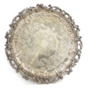A large silver-plated circular tray,