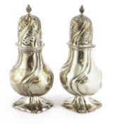 A pair of Dutch silver casters,