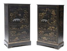A pair of chinoiserie ebonised, painted and gilt cabinets,