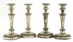 A set of four William IV silver candlesticks,