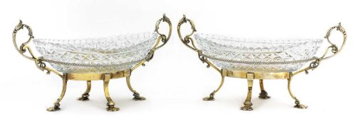A pair of gilt-plated and cut-glass oval bonbon dishes,