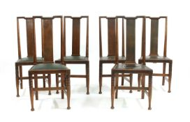 A set of six walnut Arts and Crafts chairs,