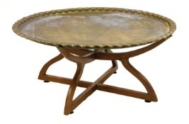 A brass top table,