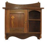 A mahogany hanging wall cabinet,