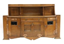 An Arts and Crafts oak cabinet,