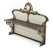 A French Art Nouveau metal and enamelled wall shelf,